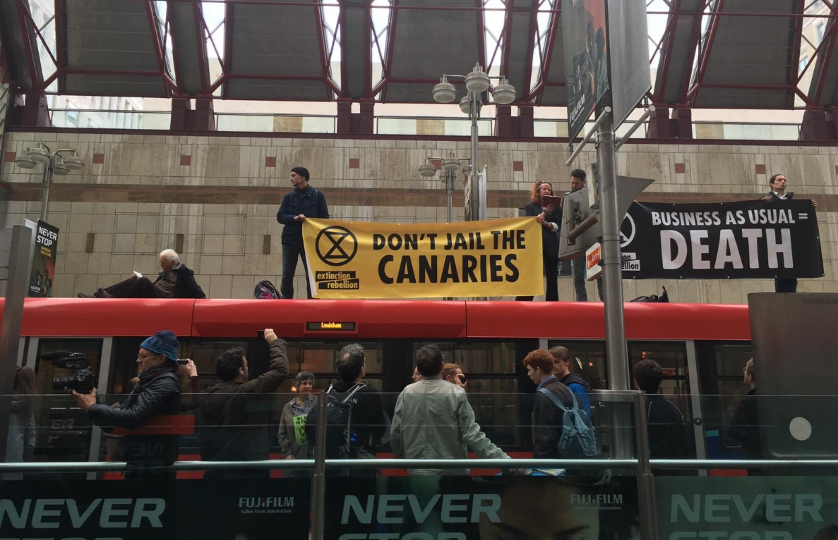 Protesters climb onto DLR at Canary Wharf again